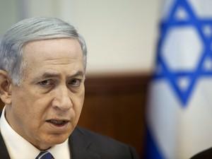 Primeiro-ministro israelense Benjamin Netanyahu durante reunião de gabinete neste domingo (21) (Foto: Reuters/Dan Balilty/Pool)
