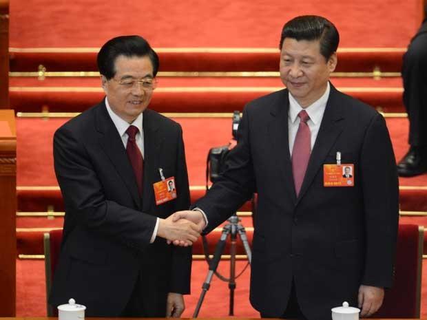 Xi Jinping, à direita, e o ex-presidente chinês Hu Jintao. (Foto: Goh Chai Hin / AFP Photo)