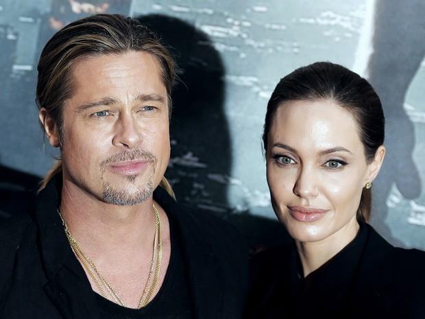 Brad Pitt e Angelina Jolie no tapete vermelho de 'Guerra Mundial Z' em Paris nesta segunda (3) (Foto: AFP PHOTO/JACQUES DEMARTHON)