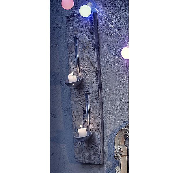 """Quer iluminar a casa de uma maneira nada convencional? O """"jantar a luz de velas"""" pode ficar muito mais divertido se as velas estiverem apoiadas em conchas. Basta pregá-las em um pedaço de madeira e sua mesa estará iluminada por objeto rústico, mas elegante. (Foto: Rogério Voltan/Casa e Comida)"""