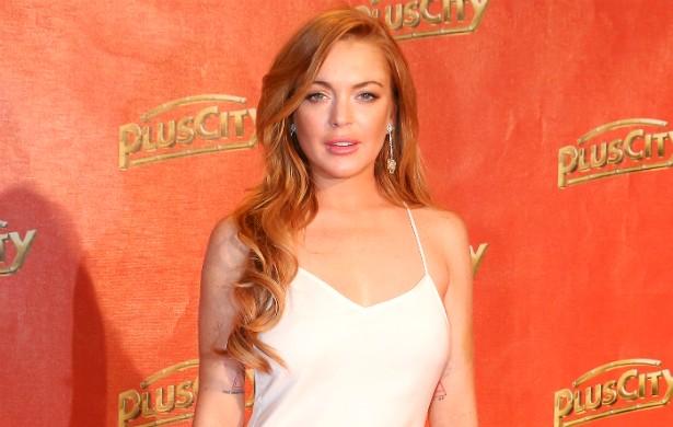 """Em março de 2014, descobriram um perfil com fotos que seriam de Lindsay Lohan em um aplicativo para pegação. A notícia chegou a fazer o dono do """"app"""" dizer publicamente que iriam começar a checar quando celebridades começassem a usar a ferramenta. (Foto: Getty Images)"""