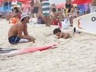Veja a grávida Juliana Paes se divertindo com a família na praia