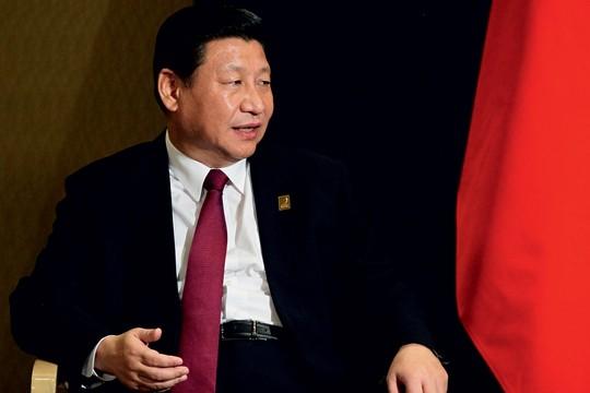 CHIOU O presidente da China, Xi Jinping, adiou reunião dos Bric para assistir ao vivo jogo da final (Foto: Getty Images)