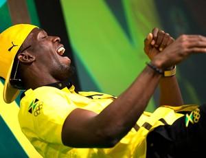 Bolt durante coletiva em Londres (Foto: AFP)
