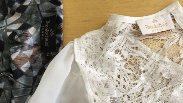 Apesar das estiquetas nas roupas, marca nega relação com oficina (Foto: BBC)