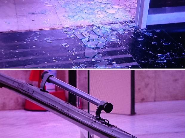 Detalhes do vidro estilhaçado e da porta quebrada em sede do Ministério da Fazenda, em Brasília, após invasão de carro (Foto: TV Globo/Reprodução)