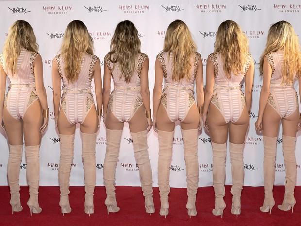 Heidi Klun (no centro) com cinco clones em festa de Halloween em Nova York, nos Estados Unidos (Foto: Neilson Barnard/ Getty Images/ AFP)