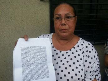 Maria Rosa, prima do vereador, afirma que recebeu de seu advogado a informação de que ela era dona da casa (Foto: Katherine Coutinho/G1)