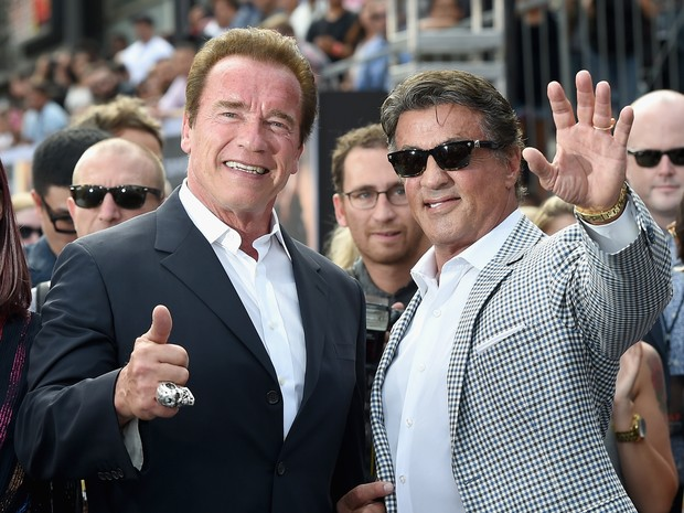 Arnold Schwarzenegger e Sylvester Stallone em première em Los Angeles, nos Estados Unidos (Foto: Kevin Winter/ Getty Images/ AFP)