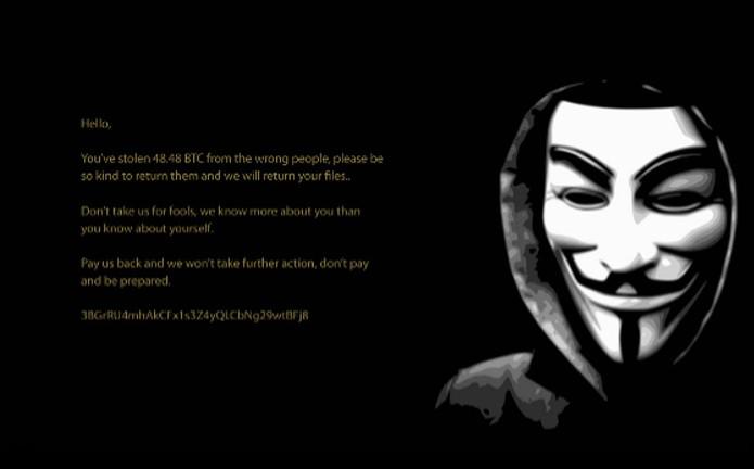 Papel de parede com a imagem de Guy Fawkes com mensagem para a vítima (Foto: Divulgação/Avast)