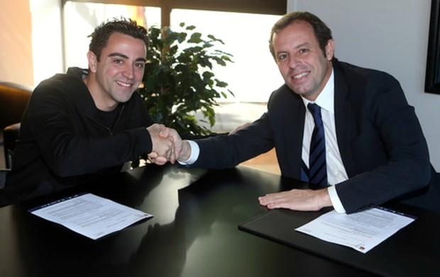 Xavi Sandro Rosell Barcelona (Foto: Reprodução / Site Oficial)