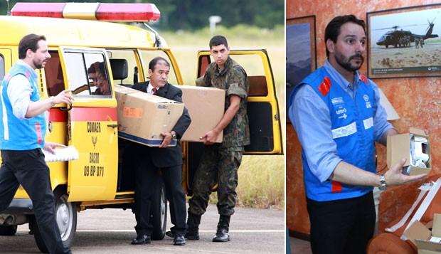 Os medicamentos doados pelo governo dos Estados Unidos chegam à base aérea de Santa Maria (RS), na tarde deste sábado (02) (Foto: Wesley Santos/Estadão Conteúdo)