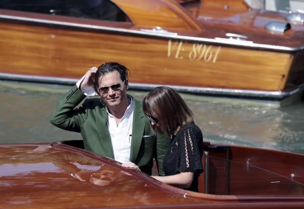 Dakota Johnson e Johnny Depp (Foto: Reuters)