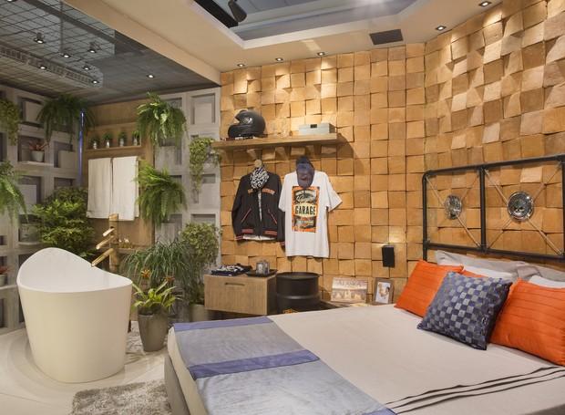 """A """"Suíte do Casal Motociclista"""", projetada por Isve Campos, é um ambiente integrado e com características industriais. Conta com tijolos aparentes, madeira, cores cinza e preto, chapa metálica e elementos customizados (Foto: Divulgação)"""