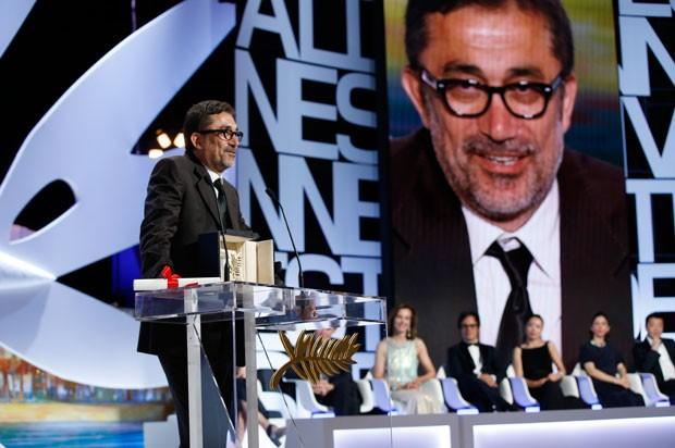 O diretor turco  Nuri Bilge Ceylan recebe, neste sábado (24) em Cannes, a Palma de Ouro por 'Winter Sleep'. (Foto: Valérie Hache/AFP)