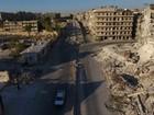 Drone registra imagens de destruição em bairro rebelde de Aleppo, na Síria