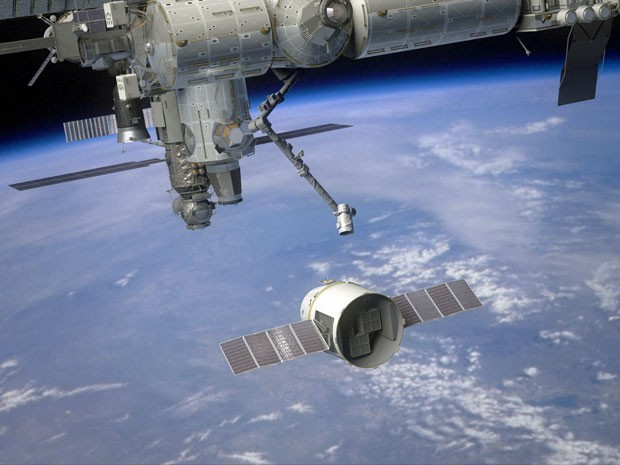 Ilustração mostra como seria acoplagem da Dragon na ISS (Foto: Space X)