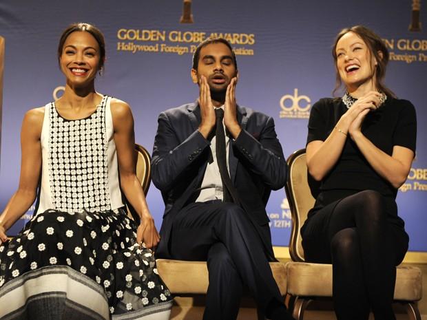 Os atores Zoe Saldana, Aziz Ansari e Olivia Wilde apresentaram as indicações ao Globo de Ouro 2014 nesta quinta-feira (12) (Foto: Chris Pizzello/Invision/AP)