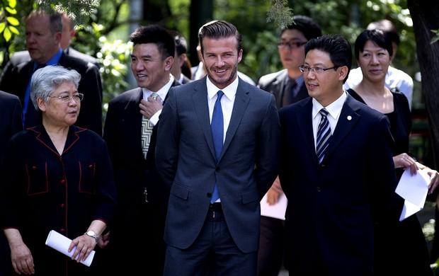 david beckham doação china (Foto: Agência AP)