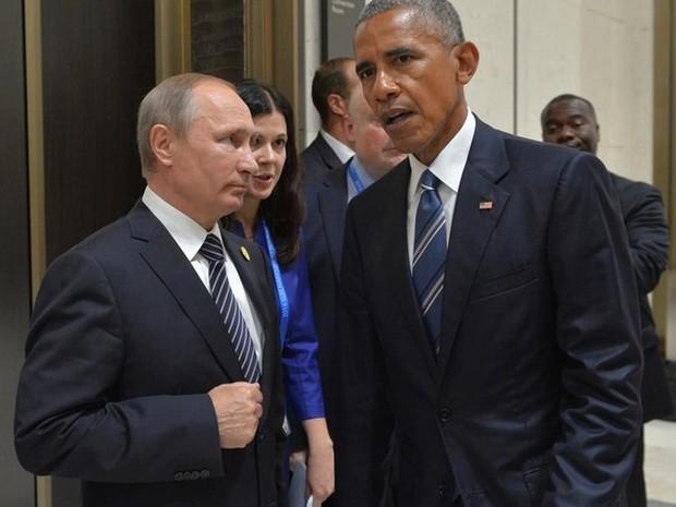 Presidente dos Estados Unidos, Barack Obama, e presidente da Rússia, Vladimir Putin, se encontraram na China nesta segunda-feira (5) (Foto: Alexei Druzhinin/ Sputnik via Reuters)