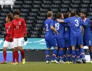 Jogadores da Croácia celebram vitória sobre a Coreia do Sul (Foto: Reuters)