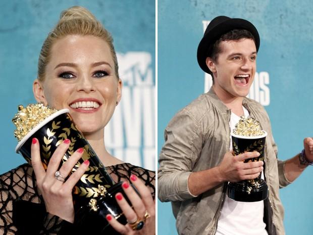 Elizabeth Banks e Josh Hutcherson, de 'Jogos vorazes', seguram prêmios vencidos nas categorias melhor interpretação feminina e masculina no MTV Movie Awards 2012 (Foto: Danny Moloshok/Reuters)