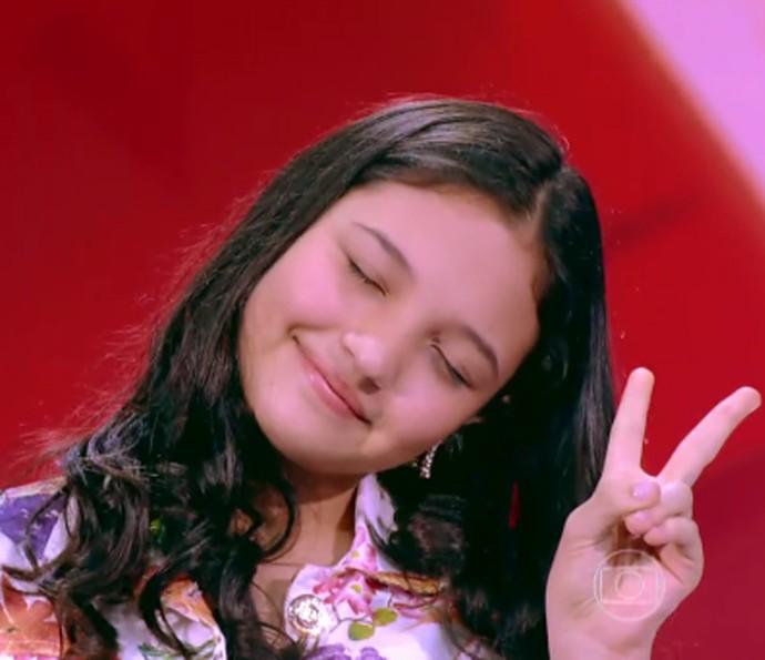 Ana Rosa relaxa durante sua audição no The Voice Kids e conquista técnicos (Foto: Tv Globo)