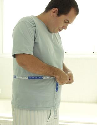 Homem gordo euatleta (Foto: Getty Images)