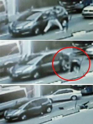 Vídeo mostra ladrão arrancando mulher de dentro do carro para roubar (Foto: Reprodução/TV Globo)