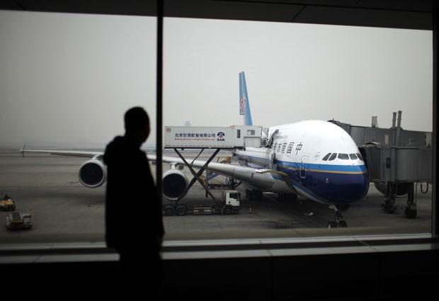 Incidente ocorreu com avião da companhia estatal Air China (Foto: Carlos Barria/Reuters)