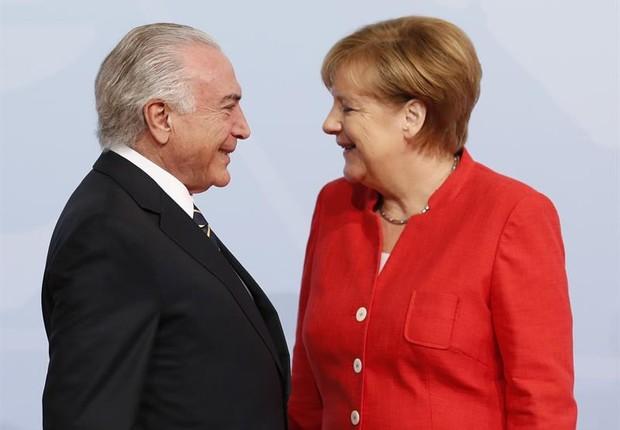 Michel Temer em Hamburgo para reunião do G-20 sorri para a chanceler alemã Angela Merkel (Foto: Friedemann Vogel Pool/EFE )