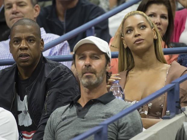 Jay-Z e Beyoncé assistem à partida de tênis no US Open em Nova York, nos Estados Unidos (Foto: Don Emmert/ AFP)