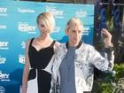 Ellen DeGeneres vai com a mulher à première de 'Procurando Dory'