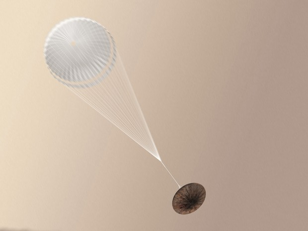 Ilustração mostra módulo Schiaparelli com paraquedas aberto; Agência Espacial Europeia (ESA) ainda não sabe se módulo sobreviveu a pouso em Marte (Foto: ESA/ATG medialab)