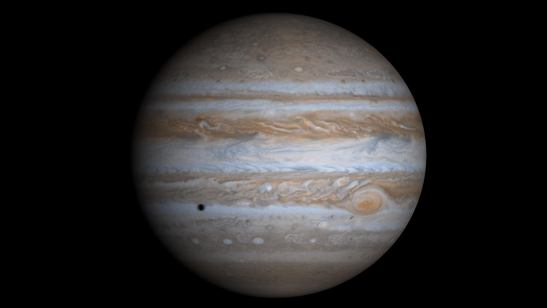 Foto em cores naturais da sonda Cassini mostra Júpiter e a projeção da sombra de uma de suas luas, Europa (Foto: NASA )
