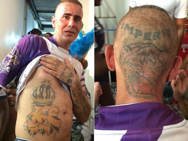 Clenildo Franco, de 27 anos, tem tanto amor pela escola que decidiu tatuar o dragão no corpo (Foto: Glauco Araújo/G1)