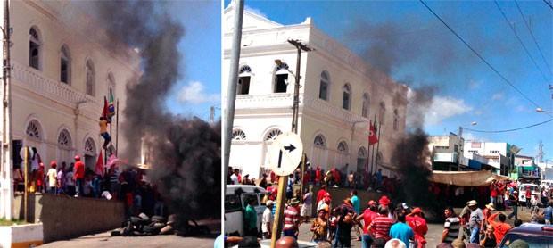 Manifestantes do MST atearam fogo em pneus e hastearam bandeira na seda da Prefeitura de Ceará-Mirim (Foto: Ari Duartte)