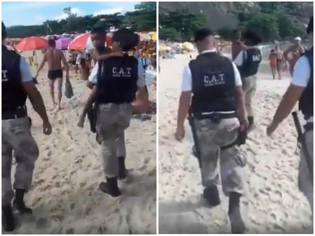 Guardas municipais levam criança no colo em Niterói (Foto: Reprodução Facebook)
