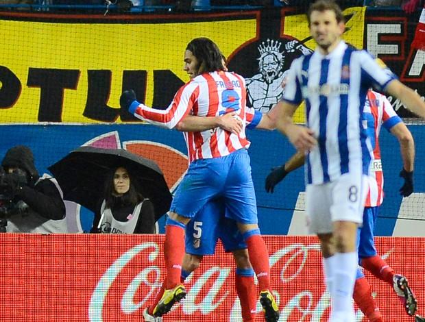 Falcão Garcia comemora gol do Atletico de Madrid sobre o Espanyol (Foto: AFP)