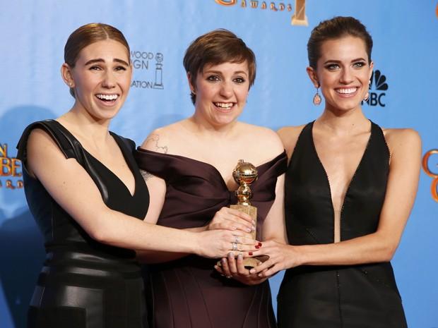 Elenco de 'Girls', que levou o prêmio de melhor série de TV na categoria musical ou comédia no Globo de Ouro 2013 neste domingo (13) (Foto: Lucy Nicholson/Reuters)