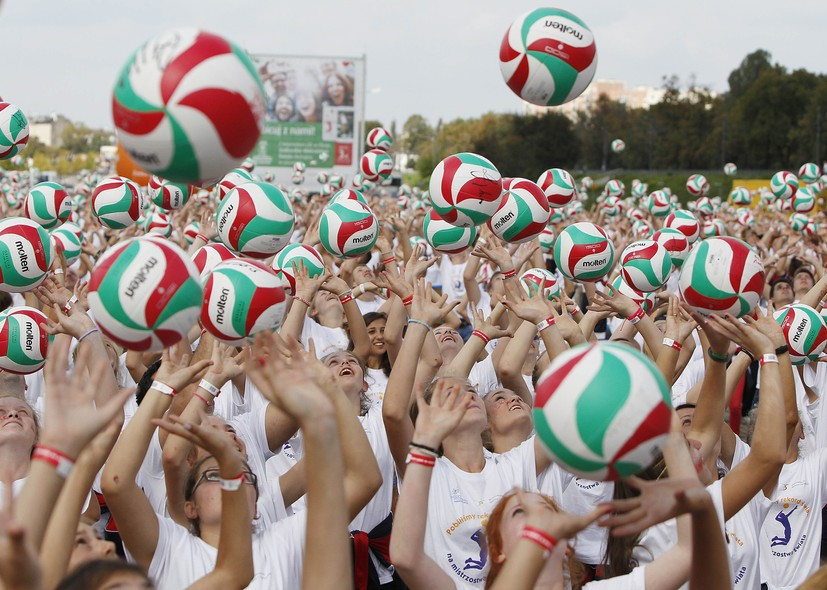 Hundreds of volleyball fans play with balls  to beat a Guinness world record during an event  in Warsaw, Poland, Saturday, Aug. 30, 2014, hours before the opening of the FIVB Men's Volleyball World Championships. (AP Photo/Czarek Sokolowski)