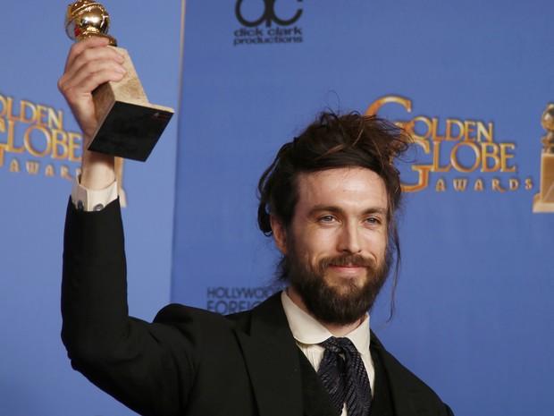 Alex Ebert vence o prêmio de melhor trilha original por 'All is lost' no 71º Globo de Ouro, que acontece neste domingo (12), em Los Angeles. (Foto: REUTERS/Lucy Nicholson)