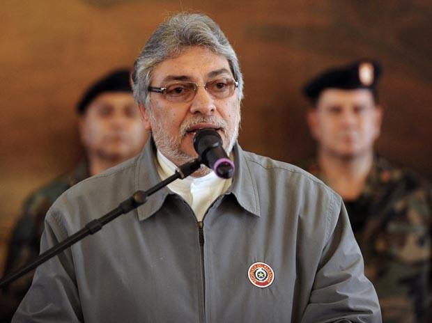 O presidente do Paraguai, Fernando Lugo, faz pronunciamento nesta quinta-feira (21) no palácio do governo, em Assunção, sobre o processo de impeachment (Foto: AFP)