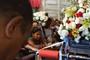 Sob chuva, baianos celebram dia da padroeira com missas (Egi Santana/G1)