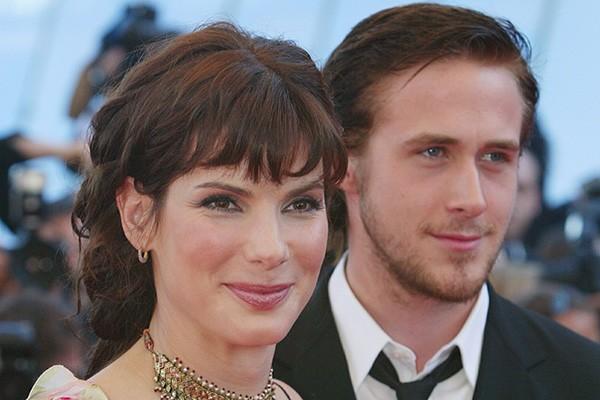 Parece improvável mas, antes de 'Diário de Uma Paixão', Ryan Gosling já namorou com Sandra Bullock. Na época, ele tinha 22 anos e ela, 38.  (Foto: Getty Images)