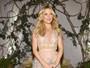 Kate Hudson usa vestido com decote duplo em première nos EUA