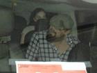 Leonardo DiCaprio tenta se esconder ao sair de boate com mulher