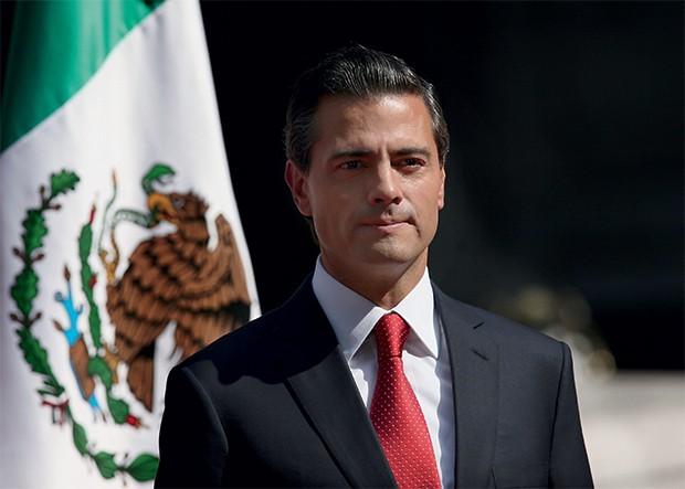CARA DE GALÃ Peña Nieto, em novembro. Sua fotogenia não serve para lidar com a crise (Foto: Marco Ugarte/AP Photo)