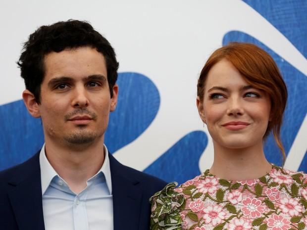 31/08: O diretor Damien Chazelle e a atriz Emma Stone participar (Foto: REUTERS/Alessandro Bianchi)