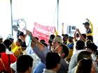 Dilma é vaiada por grevistas durante lançamento da colheita em MT